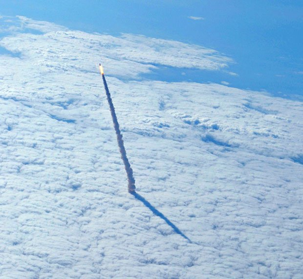 space shuttle endeavour rises above the cloud deck -#main