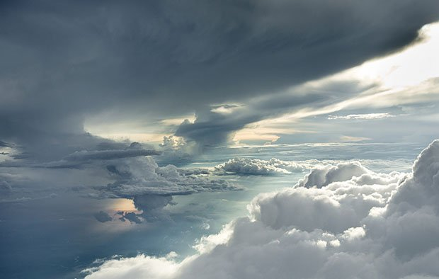 Clouds Photographed Through An Open Plane Door 4 Miles Up