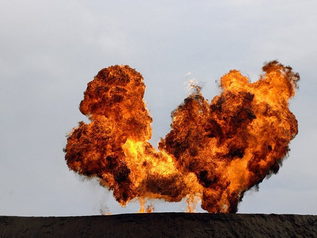 photos of terrible explosions frozen serenely in mid