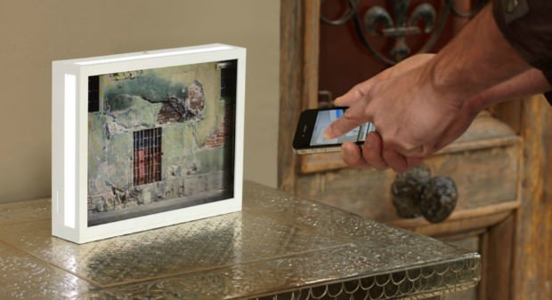 digital photo frame uses transparent screen to display photos like slide film