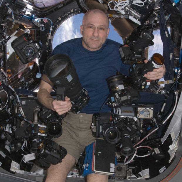 Astronaut Don Pettit Floating with His Huge Camera Collection on the ISS don mini