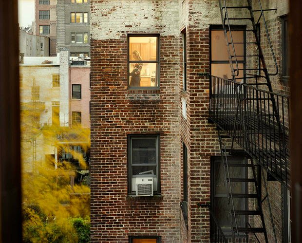 voyeuristic portraits of new yorkers seen through apartment windows. Black Bedroom Furniture Sets. Home Design Ideas