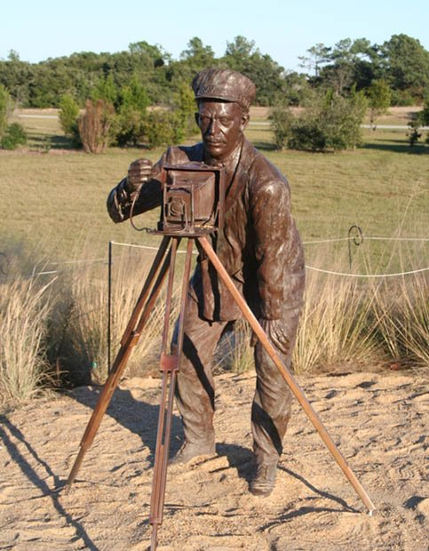 A bronze sculpture of John Daniels located at the Wright Brothers Memorial