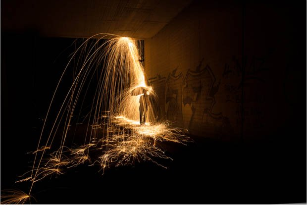A creative light painting photograph that makes sparks look like rain - Add spark wall art picture lights ...