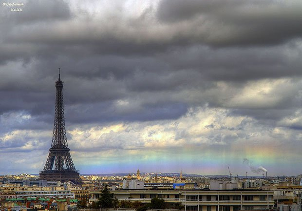 Photographer Snaps a Horizon Rainbow Alongside the Eiffel Tower