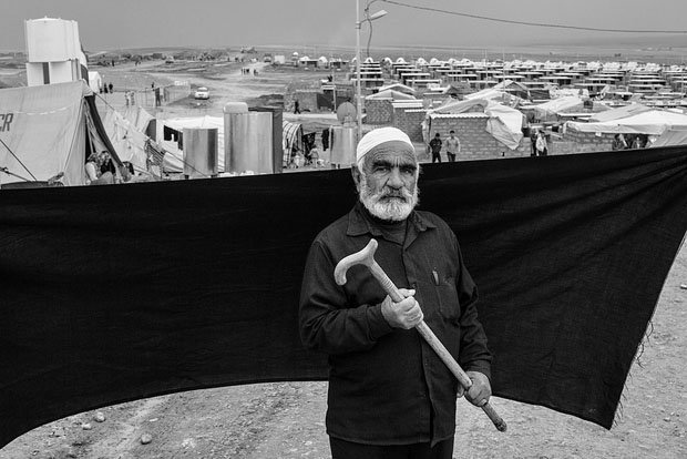 "The most important thing Ahmed was able to bring with him is the cane he holds in this photograph. Without it, he says, he would not have made the two-hour crossing on foot to the Iraqi border. ""The only other thing I have left is this finger,"" he said. ""All I want now is for my family to find a place where they can be safe and stay there forever. Never should we need to flee again."""