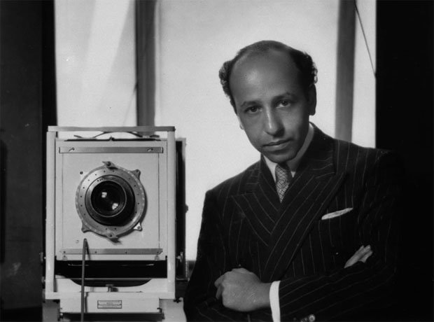 Yousuf Karsh standing next to his camera in a self portrait