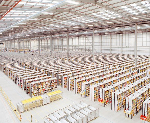 "A photo from the series. ""The interior of Amazon's giant fulfilment centre is the size of nine football pitches. The efficiency of these warehouses is what enables Amazon to put parcels on customers' doorsteps so quickly."""