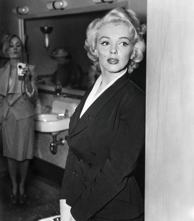 Borsi sneaking a shot of Marilyn Monroe from inside a bathroom