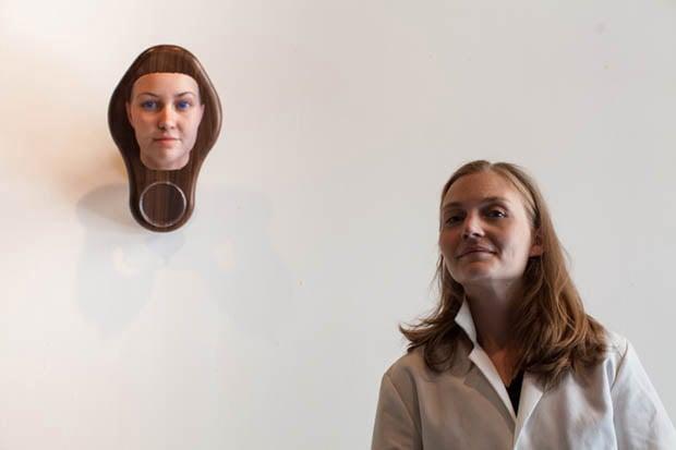 Heather Dewey-Hagborg posing with her self-portrait DNA sculpture. Photo by Dan Phiffer