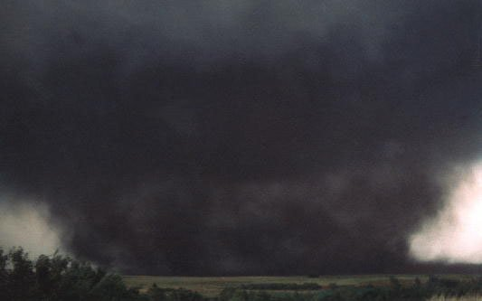A photograph of a wedge tornado in Oklahoma that was nearly a mile wide.