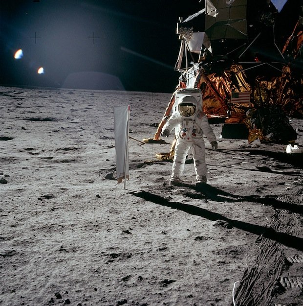 Apollo 11 astronaut Buzz Aldrin sets up a solar wind experiment on the moon.