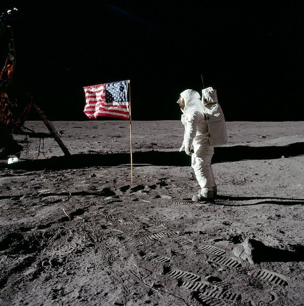 Apollo 11 astronaut Buzz Aldrin salutes the United States flag while Neil Armstrong photographs him. A moment caught on 16mm film here.