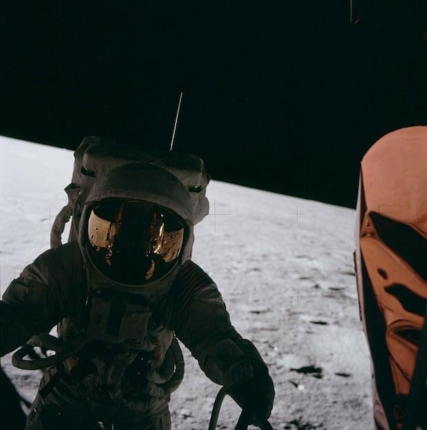 Apollo 12 astronaut Pete Conrad exiting the lunar module.