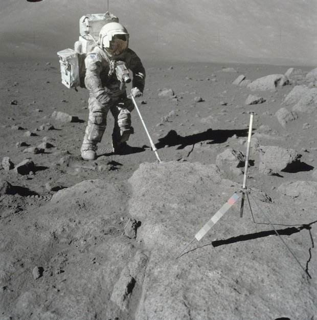 Apollo 17 astronaut Harrison Schmitt collecting a soil sample on the south side of the rim boulders at Station 5. Apollo 17 was the last manned space flight to travel beyond low Earth orbit.