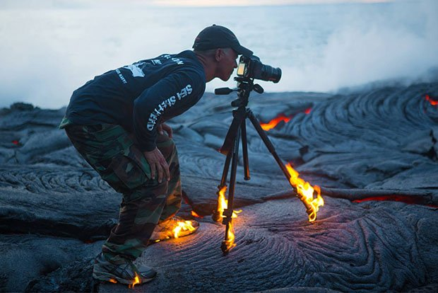 Photographer Gets So Close to Lava That His Shoes and Tripod Catch on Fire