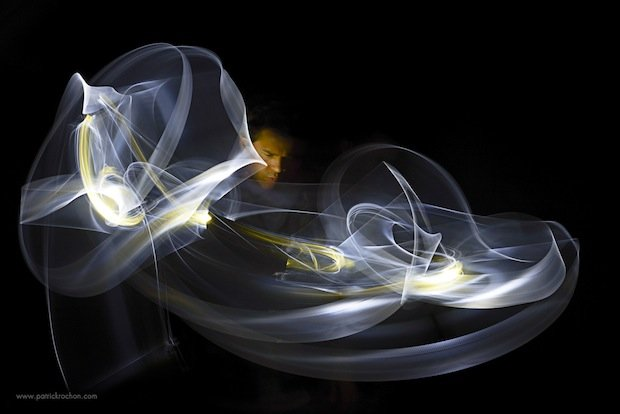Beautiful Abstract Light Paintings Created With Lighted Swords in Pitch Darkness