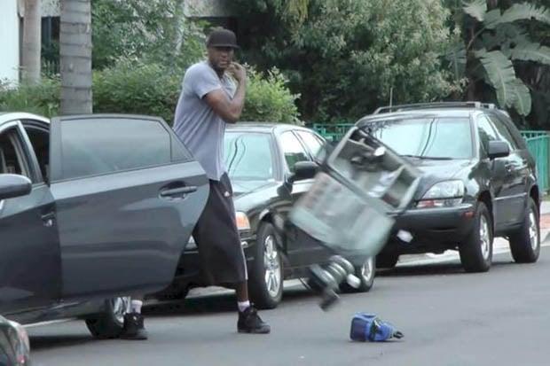 NBA Player Lamar Odom Calmly Destroys Paparazzis Gear on the Street stillframe