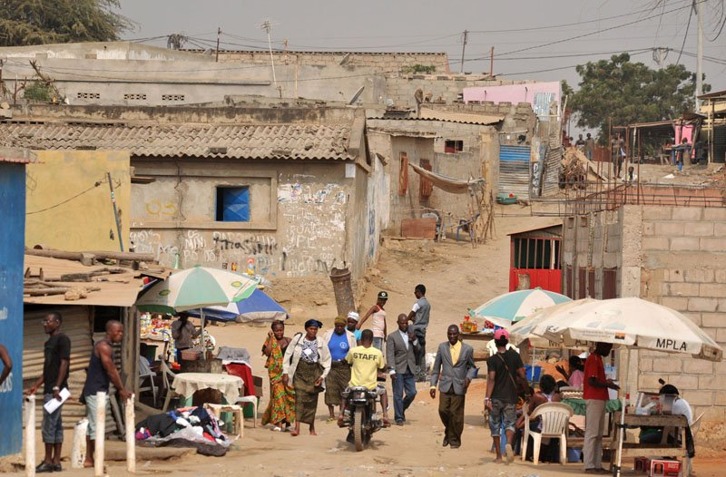 Angolans walk the side streets on the outskirts of the capital city Luanda.