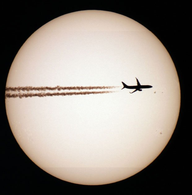 Photographer Captures Incredible Photos of Planes in Front of the Sun and Moon