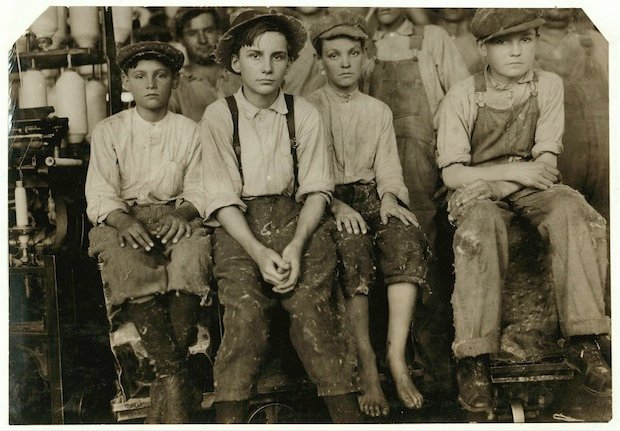 Some of the younger boys working in the Brazos Valley Cotton Mill at West. One, Charlie Lott was thirteen years old according to Family Record, another Norman Vaughn apparently twelve years old was under legal age according to one of the other boys there, Calvin Caughlin who did not appear to be fifteen years old himself. These and two girls that I proved to be under legal age were all working in this small mill. It was an exceptional case, but it it [i.e., is] likely that as the children become tired of school later in the year, there will be many more at work. Location: West, Texas.