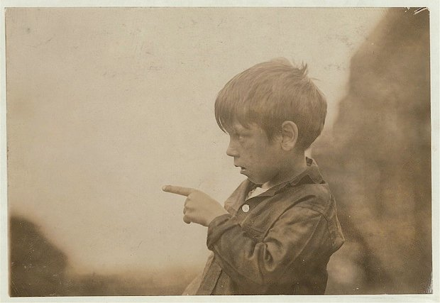 """I cut my finger off, cutting sardines the other day."" Seven year old Byron. Location: Eastport, Maine."