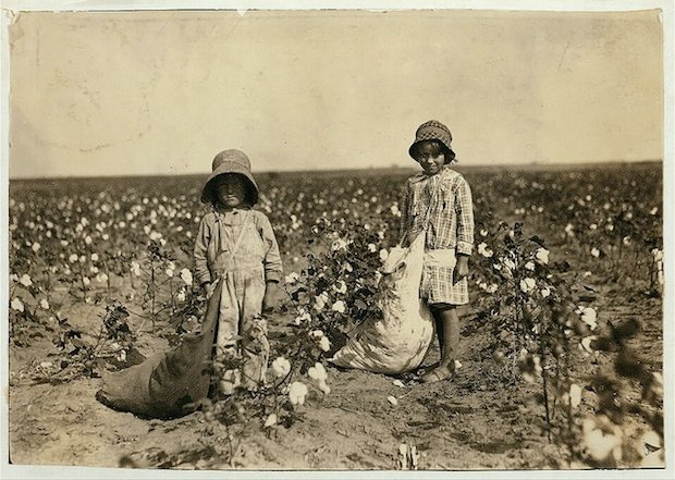 "Jewel and Harold Walker, 6 and 5 years old, pick 20 to 25 pounds of cotton a day. Father said: ""I promised em a little wagon if they'd pick steady, and now they have half a bagful in just a little while.""  Location: Comanche County, Oklahoma"