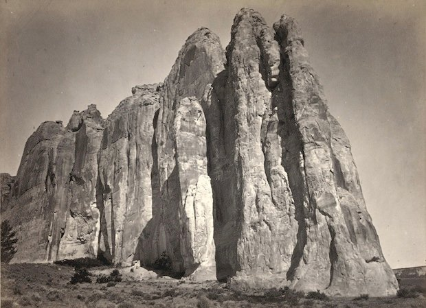 The south side of Inscription Rock (now El Morro National Monument), in New Mexico. Taken in 1873