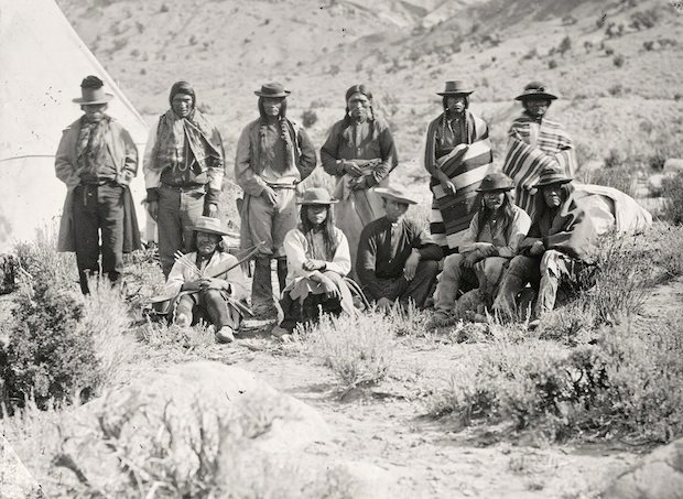 Pah-Ute (Paiute) Indian group, near Cedar, Utah. Taken in 1872.