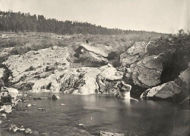 Man bathing in Pagosa Hot Spring, Colorado. Taken in 1874.