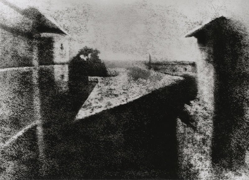 "Rediscovered in 1952 by photo historians Helmut and Alison Gernsheim, the ""First Photograph"" was first depicted in this well-known reproduction that was retouched by Helmut Gernsheim prior to its international release. Joseph Nicéphore Niépce's ""View from the Window at Le Gras."" 1826 or 1827. Gernsheim Collection, Harry Ransom Center / The University of Texas at Austin."