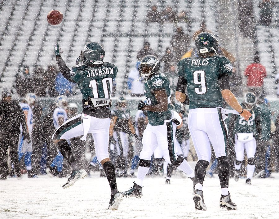 DeSean Jackson, left, LeSean McCoy, center, and Nick Foles, right, run through the snow as they warm up before their game against the Detroit Lions on Sunday afternoon, December 8, 2013.