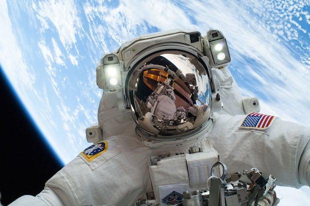 Astronauts Beam Down an Epic Christmas Eve Spacewalk Portrait