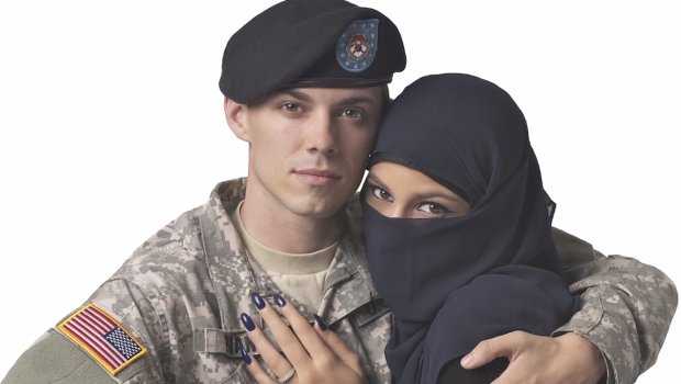 Ad Agency Rejects 'Uncomfortable' Photo of Muslim Woman Embracing a US Soldier from Its Times Square Billboards