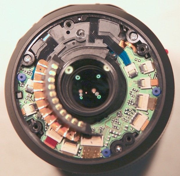 Panasonic-Leica 45mm. The 4 empty plastic holes are where the lens mount attaches. The 3 screws still in place attach this plastic piece to the next plastic piece in the lens barrel.