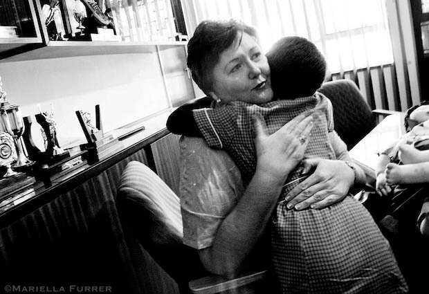 A 10yr old girl gets a hug after talking to Tinka Labuschagne, a senior education specialist with the Ministry of Education. Tinka was called in to the school after the young girl disclosed to her teacher the previous day that her brother and two of his friends had been sexually abusing her since she was 6yrs old. She alleged that she had been raped, sodomised and forced to perform oral sex on the boys. She had severe problems with her eyes, a sore throat,  and discomfort in vagina. It was suspected that she was suffering from gonorrhea. Her 16yr old sister was also being forced to have sex with the boys. Thembisa, January 2006