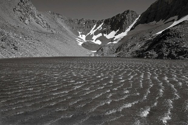 A strong summer wind makes whitecaps on Dana Lake.
