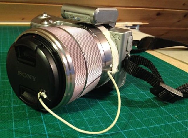 A Super Simple DIY Lens Cap Holder that Will Cost You Almost Nothing
