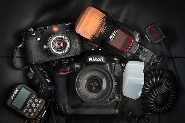 (L-R) Phottix Odin set, Leica M, Nikon D4s, Nikon SB-910 Speedlight, Tungsten CTO Gel, Dome Diffusor, SC-29