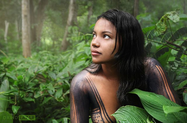 Taken while staying in an indigenous community in Maraba, Brazil, the young lady is leaning on her knee.