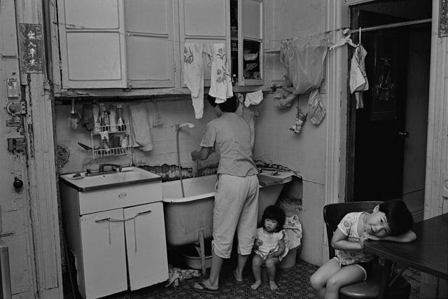 Rebecca with her children in their kitchen, 1982