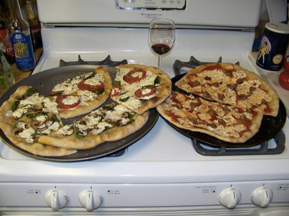 """The program automatically captioned this: """"Two pizzas sitting on top of a stove top oven"""""""