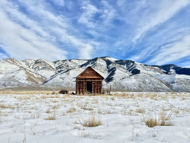 Shot by Cole R. in Star Valley Ranch, WY. Establishing a main focus have remarkable effect. Right here, wispy clouds lead the eye toward hut and produce a more powerful sense of focus.