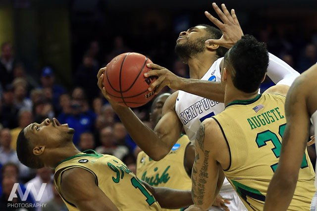 Kentucky Wildcats guard Andrew Harrison (5) goes up for a shot while guarded by Notre Dame Fighting Irish guard Demetrius Jackson (11) during the final minutes of the second half in the finals of the midwest regional of the 2015 NCAA Tournament at Quicken Loans Arena. Kentucky won 68-66.