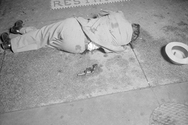 A murder victim lying on a street in 1936.