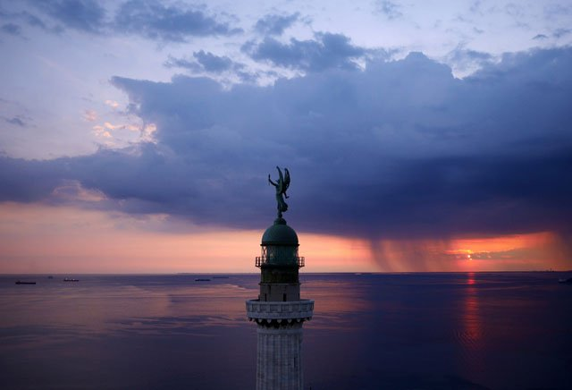 The Vittoria Light, overlooking the Gulf of Trieste at sunset.
