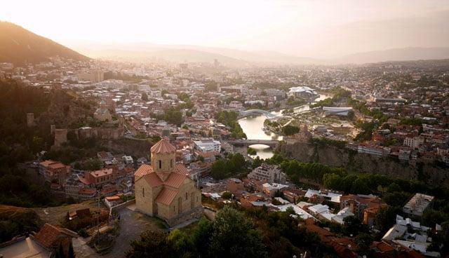 The Mtkvari River winding through Tbilisi, Georgia's elegant capital.