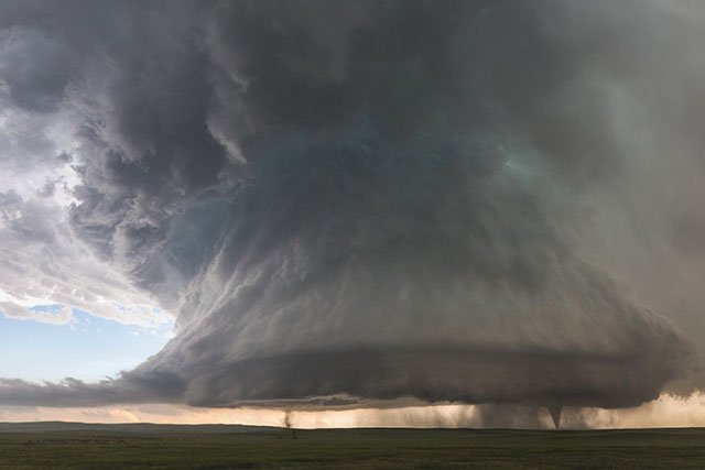 Photographer Captures Twin Tornados Under a Huge Supercell Storm Cloud