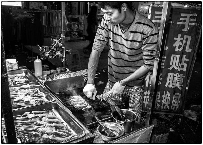 Squid man at the night market – Qingxi, China