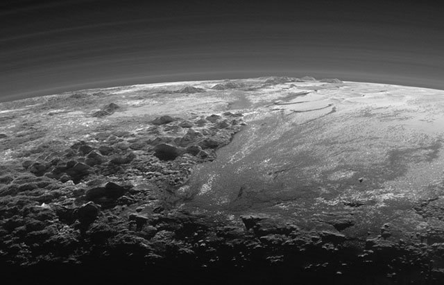 A Photo of a Sunset Over the Mountains of Pluto